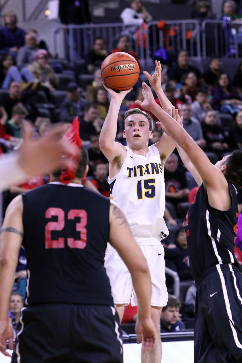 Noah Freidel of Tea Area puts up a shot between several Pine Ridge defenders during Friday's semifinal game at the Premier Center in Sioux Falls.
