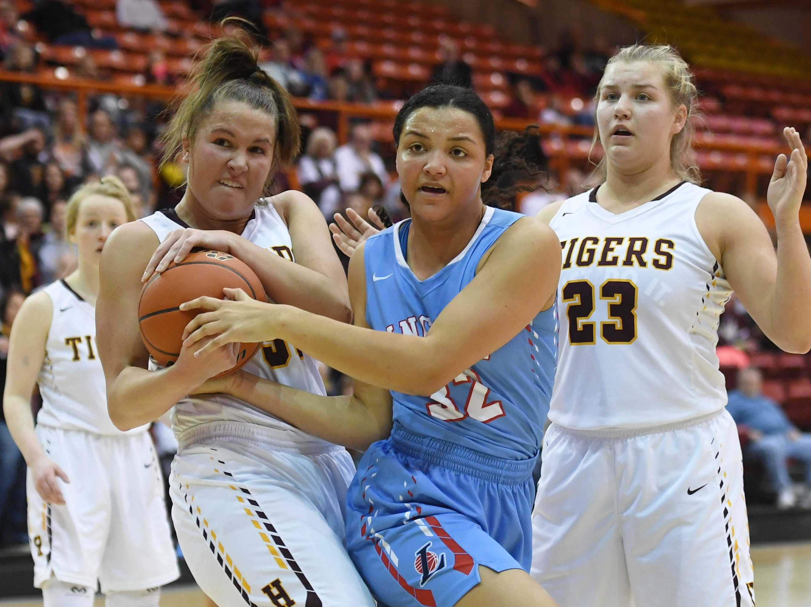 Lincoln's Sydnaya Dunn goes against Harrisburg's Jeniah Ugofsky during the game in the Class AA semifinals Thursday, March 15, in Rapid City.