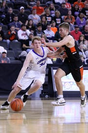 Sioux Falls Christian's Gavin Schipper drives the baseline against Quincy Ihnen of Lennox during Friday night's semifinal at the Premier Center in Sioux Falls.