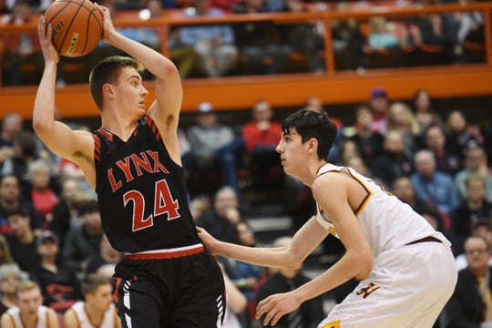Brandon Valley's Evan Talcott goes against Harrisburg's Blair Slaughter during the game in the Class AA semifinals Thursday, March 15, in Rapid City.