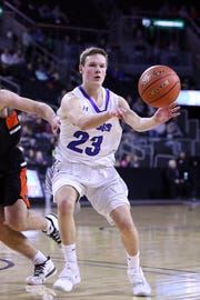 Xavier Van Beek of Sioux Falls Christian passes the ball away from a Lennox defender during Friday night's semifinal at the Premier Center.