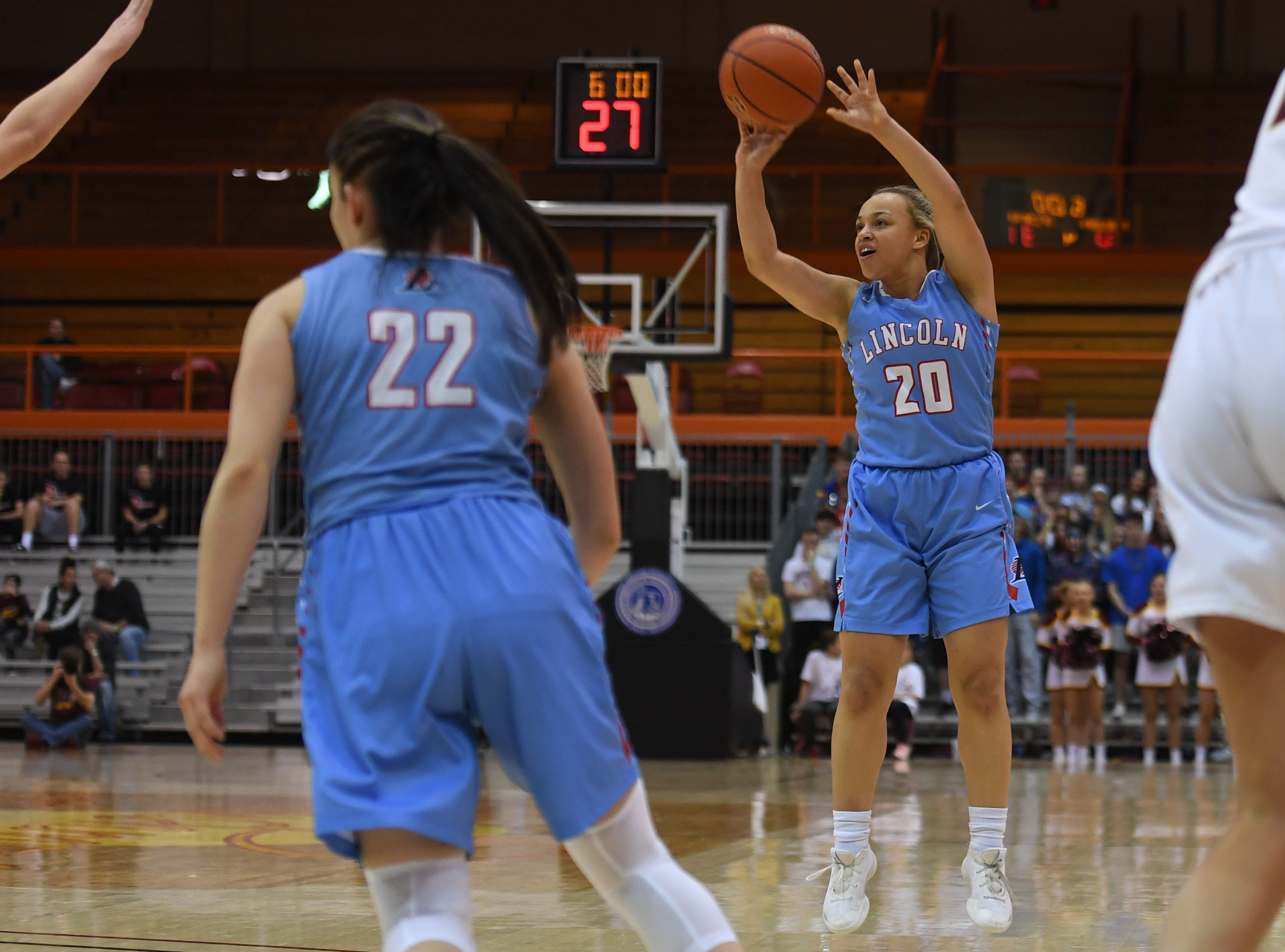 Lincoln's Mya Wilson takes a shot against Harrisburg in the Class AA semifinals Thursday, March 15, in Rapid City.