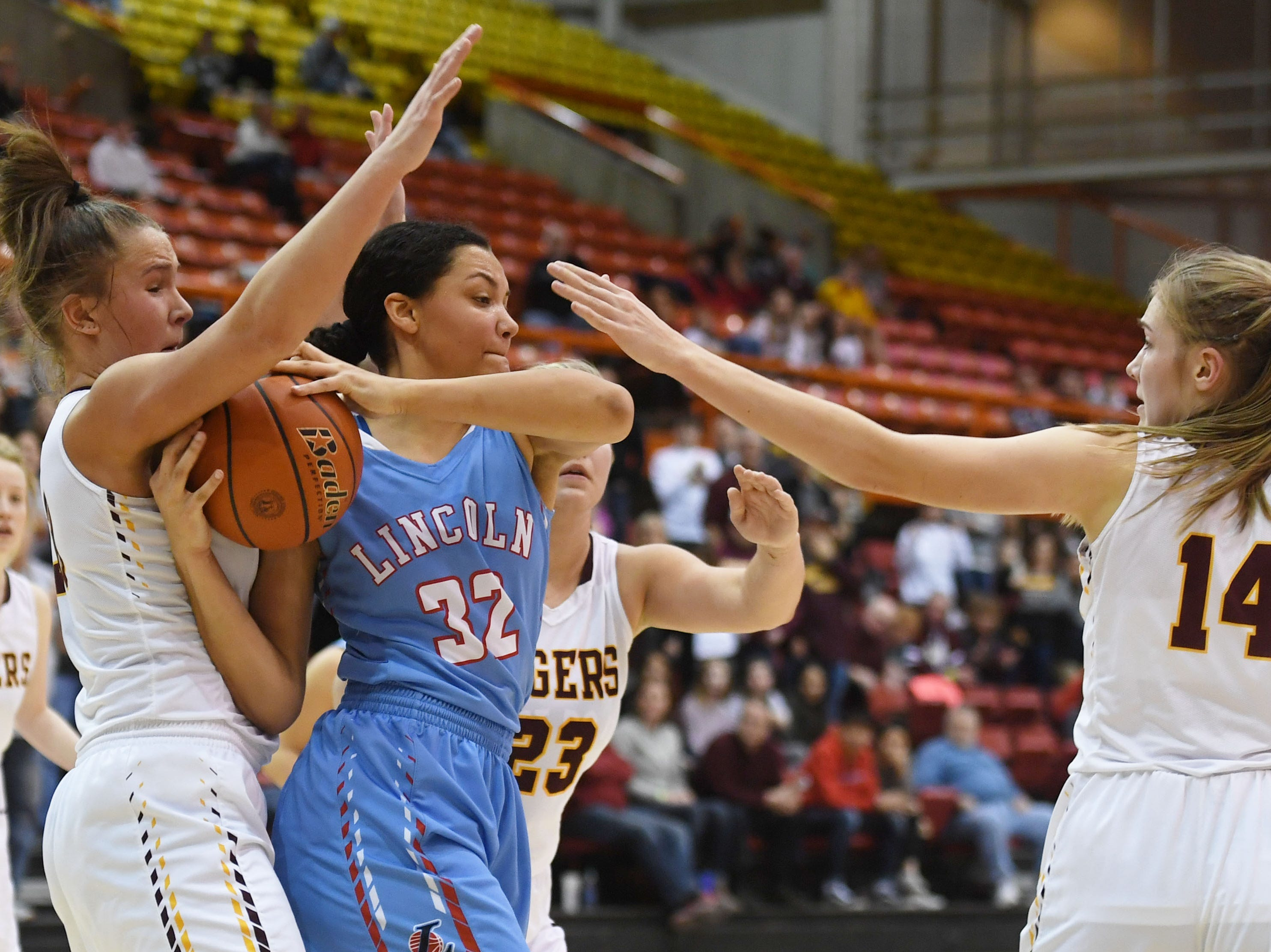 Lincoln's Sydnaya Dunn goes against Harrisburg defense during the game in the Class AA semifinals Thursday, March 15, in Rapid City.