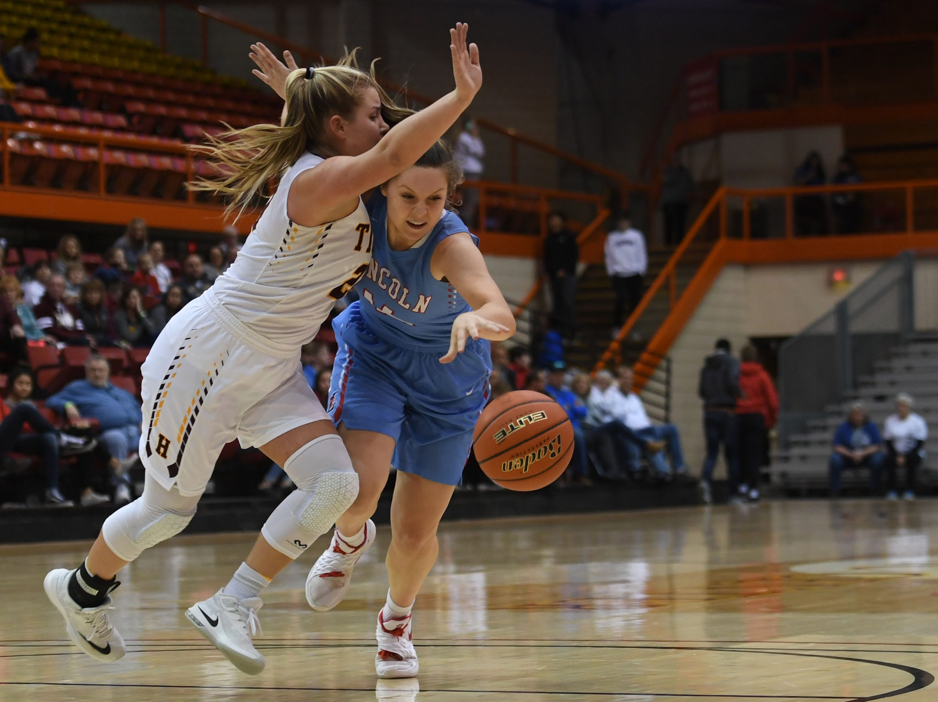 Lincoln's Emma Osmundson goes against Harrisburg's Faith Van Holland during the game in the Class AA semifinals Thursday, March 15, in Rapid City.