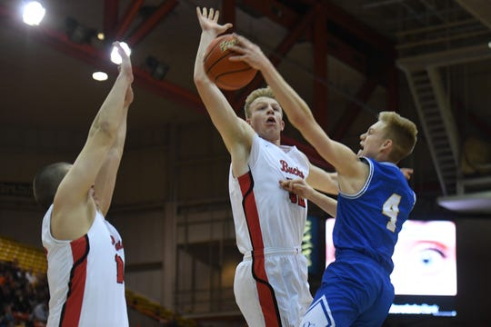Yankton's Matthew Mors attempts to block a shot by O'Gorman's Luke Ronsiek in the Class AA semifinals Thursday, March 15, in Rapid City.