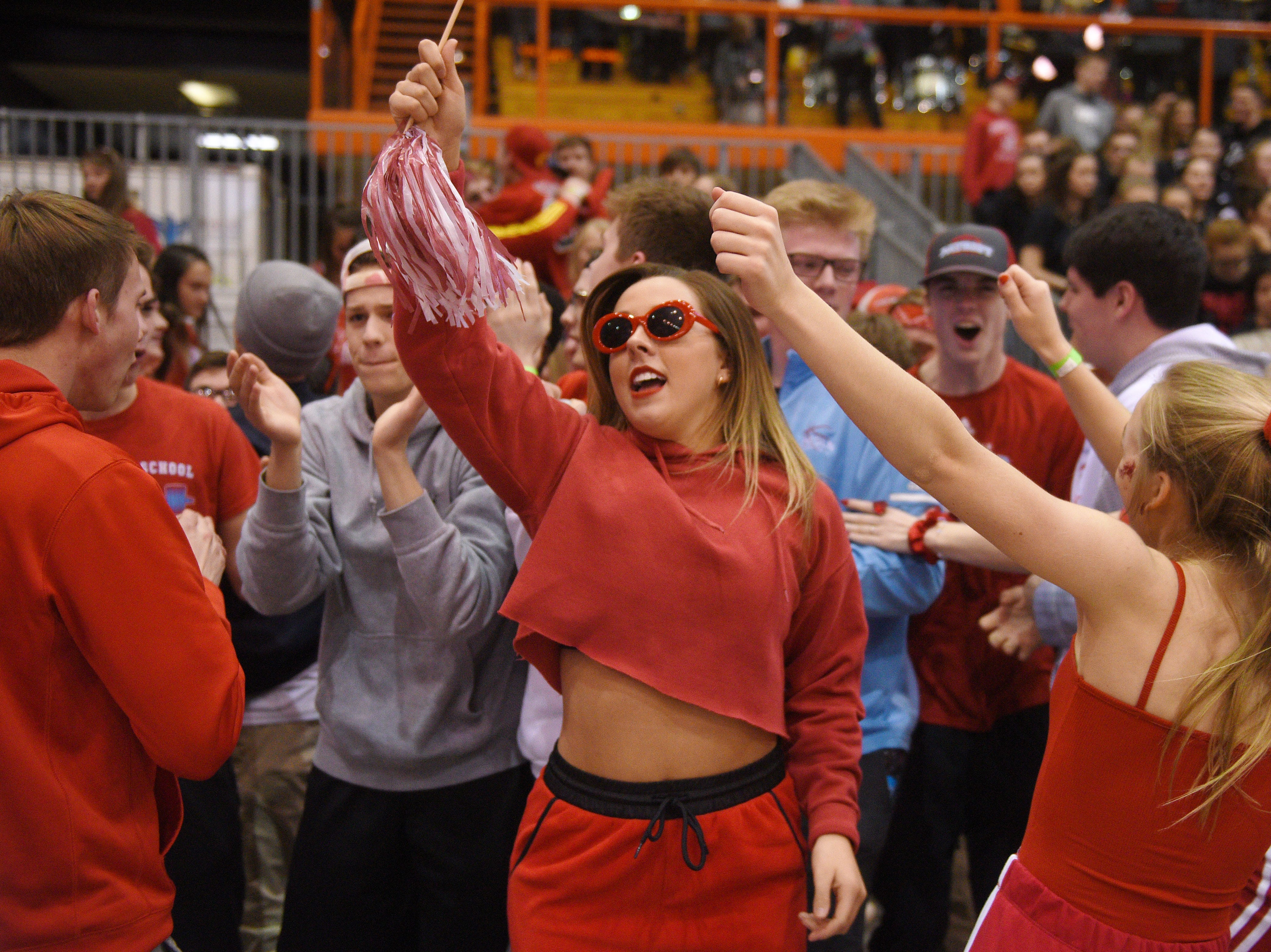 Lincoln's student section celebrates after their win against  Harrisburg in the Class AA semifinals Thursday, March 15, in Rapid City.