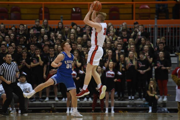 Yankton's Matthew Mors takes a shot against O'Gorman's Canyon Bauer during the game in the Class AA semifinals Thursday, March 15, in Rapid City.