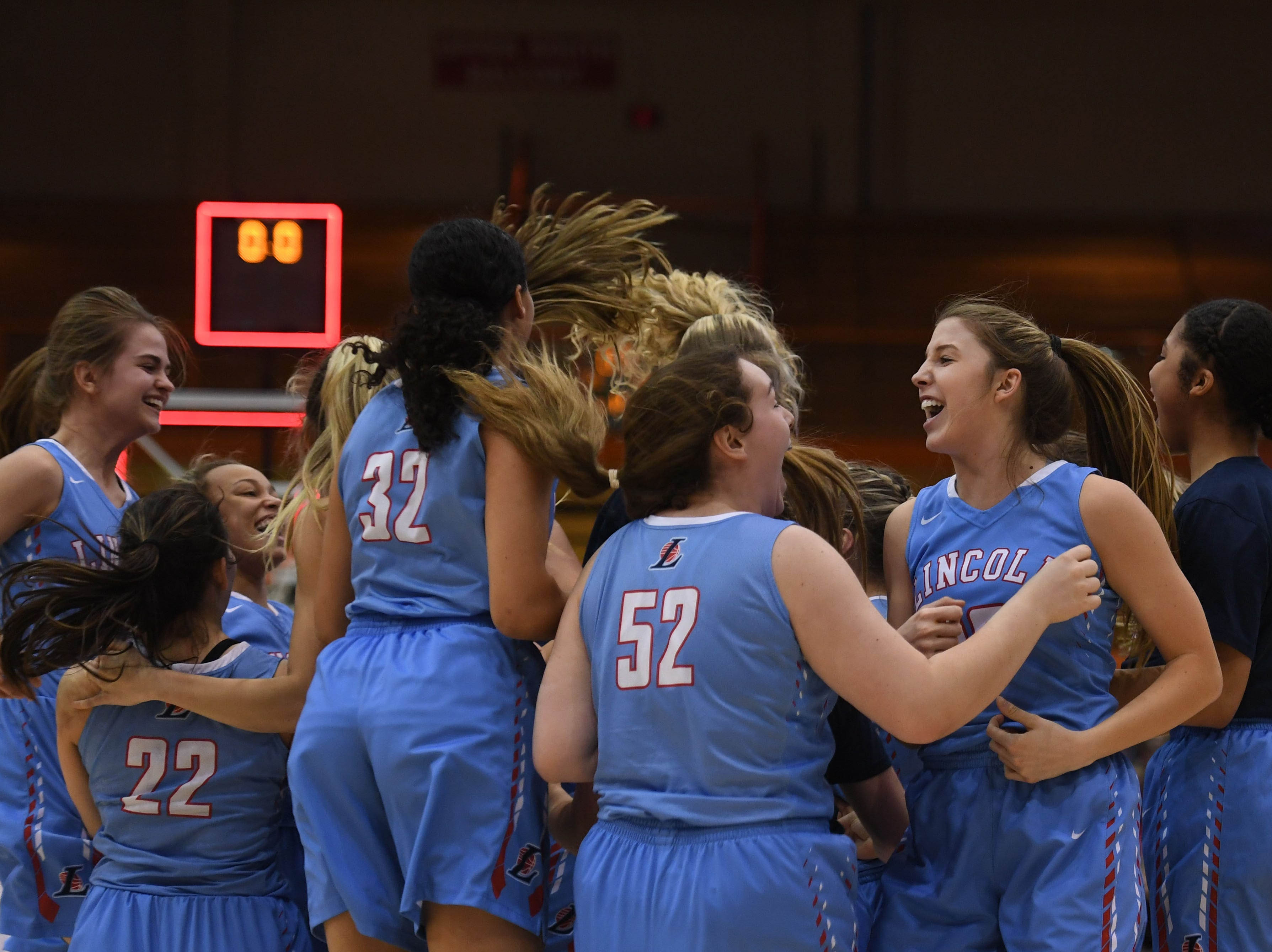 Lincoln celebrates their win against Harrisburg in the Class AA semifinals Thursday, March 15, in Rapid City.