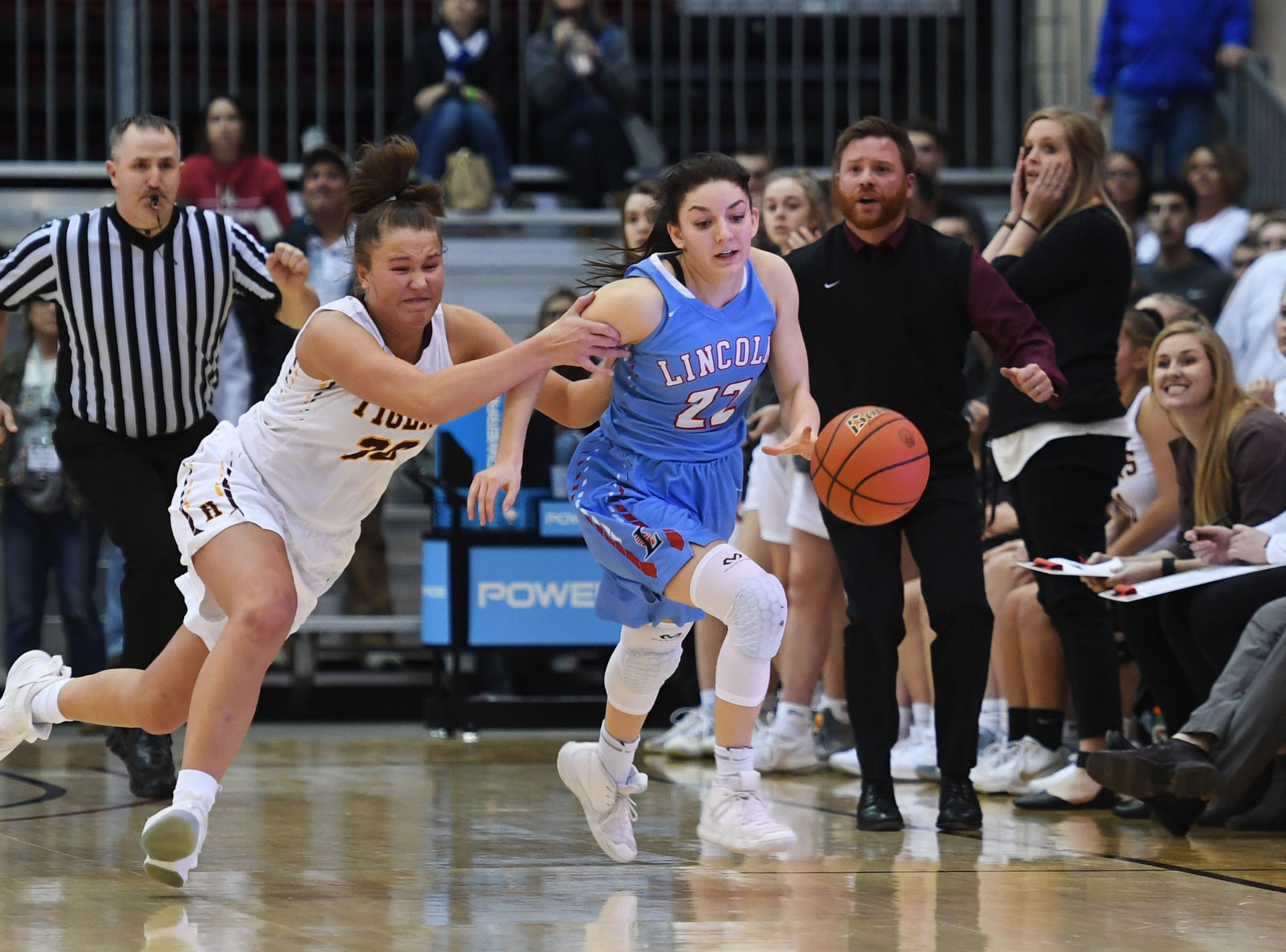 Harrisburg's Jeniah Ugofsky attempts to stop Lincoln's Brooke Brown in the fourth period in the Class AA semifinals Thursday, March 15, in Rapid City.