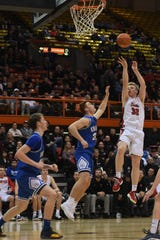 Yankton's Matthew Mors takes a shot against O'Gorman defense during the game in the Class AA semifinals Thursday, March 15, in Rapid City.