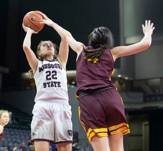 Missouri State's Alexa Willard shoots over Loyola's  Abby O'Connor during the Bears win over the Ramblers in the MVC Tournament in Moline, Ill on Friday, March 15, 2019.