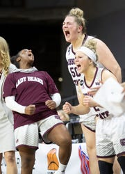 The Lady Bears bench reacts to a bucket during the second half of Missouri State's win over Loyola in the MVC Tournament in Moline, Ill on Friday, March 15, 2019.