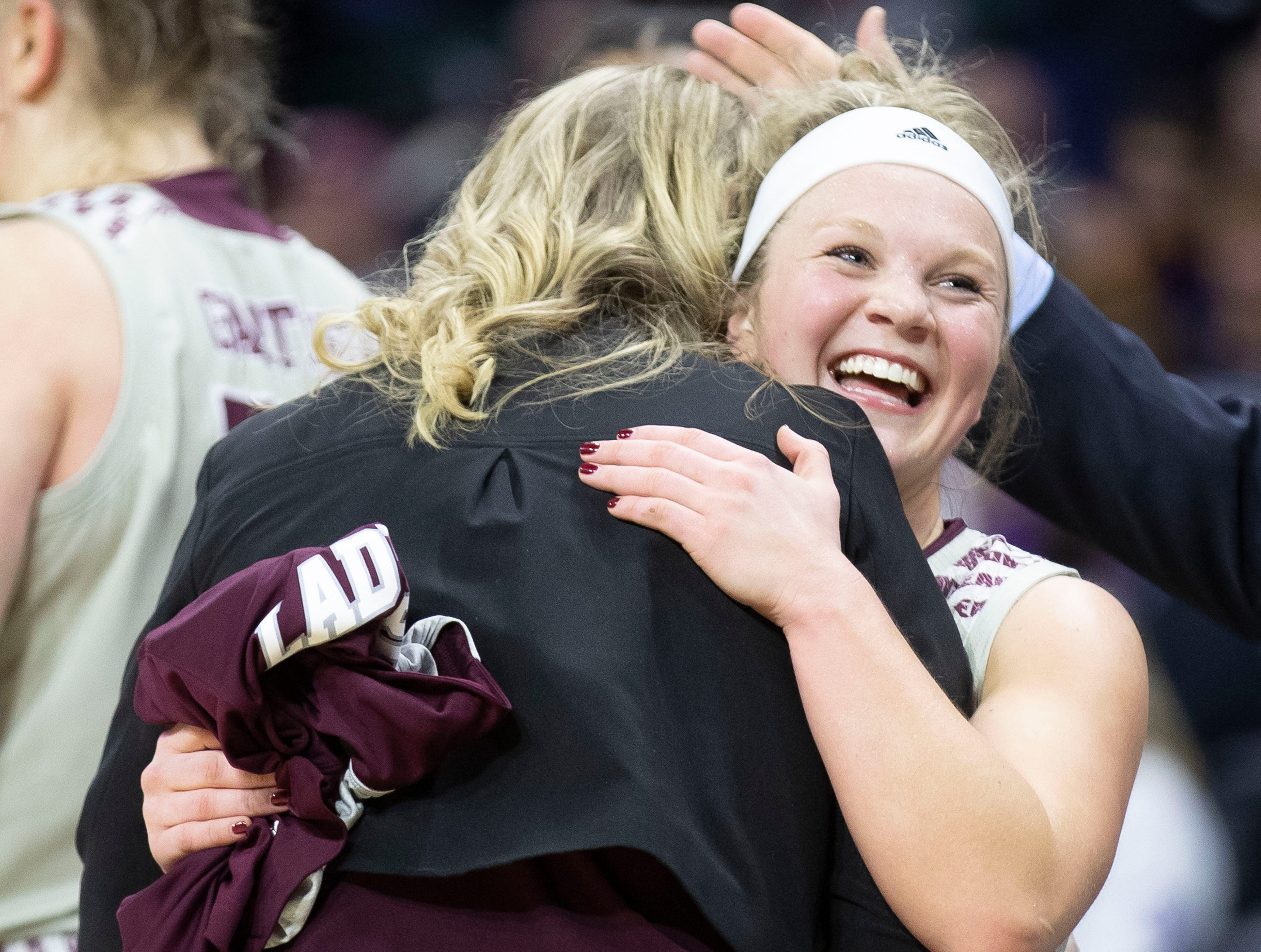 Elle Ruffridge hugs coach Kellie Harper in the second half of the Lady Bears' win over Northern Iowa in the MVC Tournament in Moline, Ill. on Saturday, March 16, 2019.