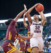Missouri State's  Jasmine Franklin Drives past a Loyola defender during the Bears win over the Ramblers in the MVC Tournament in Moline, Ill on Friday, March 15, 2019.