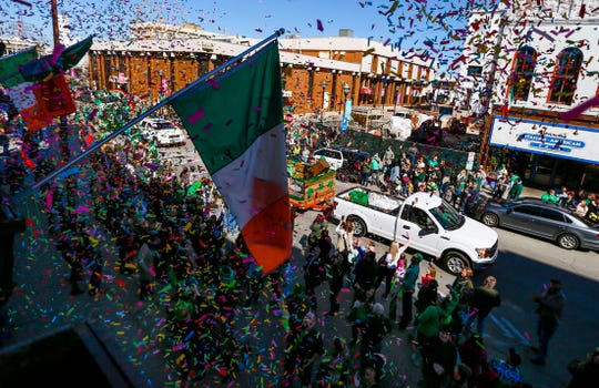 Confetti rains down from above Finnegan's Wake on parade goers along South Avenue during the St. Patrick's Day Parade on Saturday, March 16, 2019.