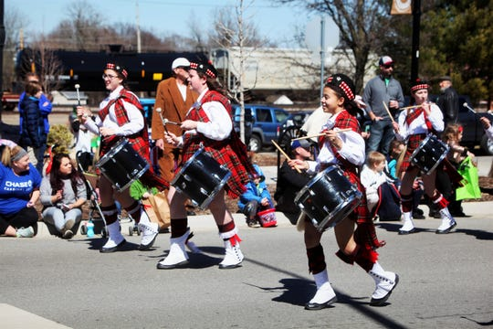 Members of Central High School's Kilties drum and bugle corps march in the St. Patrick's Day parade March 16, 2019.