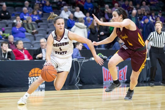 Missouri State's Danielle Gitzen drives past Loyola's Abby O'Connor during Lady Bears win over Loyola in the MVC Tournament in Moline, Ill on Friday, March 15, 2019.