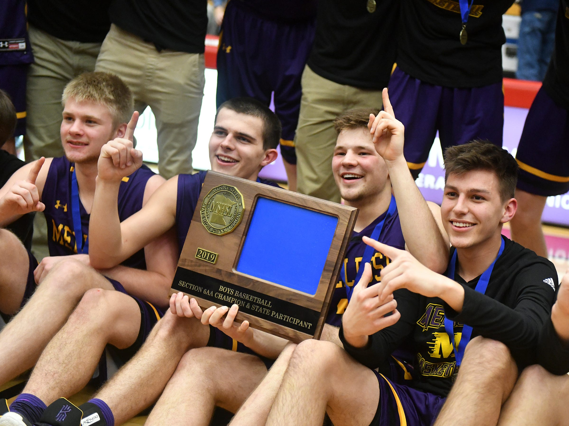 Melrose players pose with their first-place trophy following the Friday, March 15, Section 6-2A championship game at Halenbeck Hall in St. Cloud.