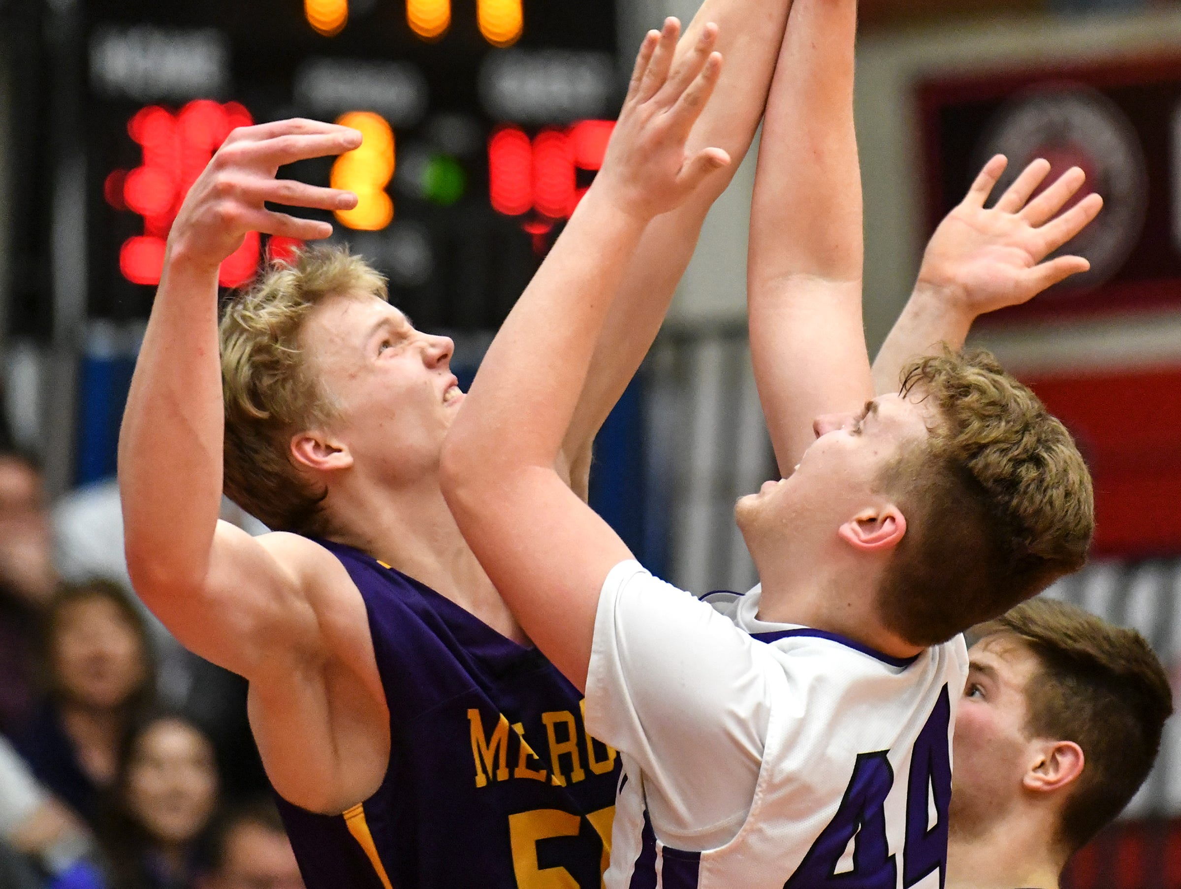 Daniel Klassen of Melrose tries to block a shot by Albany's Andrew Hahn during the second half of the Friday, March 15, Section 6-2A championship game at Halenbeck Hall in St. Cloud.