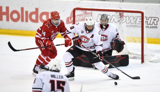 St. Cloud State's Jon Lizotte gets control of the puck in front of the SCSU goal during the first period of the Friday, March 15, game at the Herb Brooks National Hockey Center in St. Cloud.