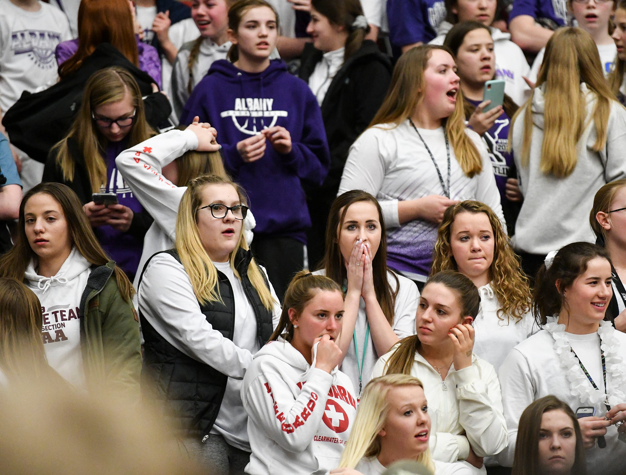 Albany fans react as Melrose is named the winning team following  the second half of the Friday, March 15, Section 6-2A championship game at Halenbeck Hall in St. Cloud.
