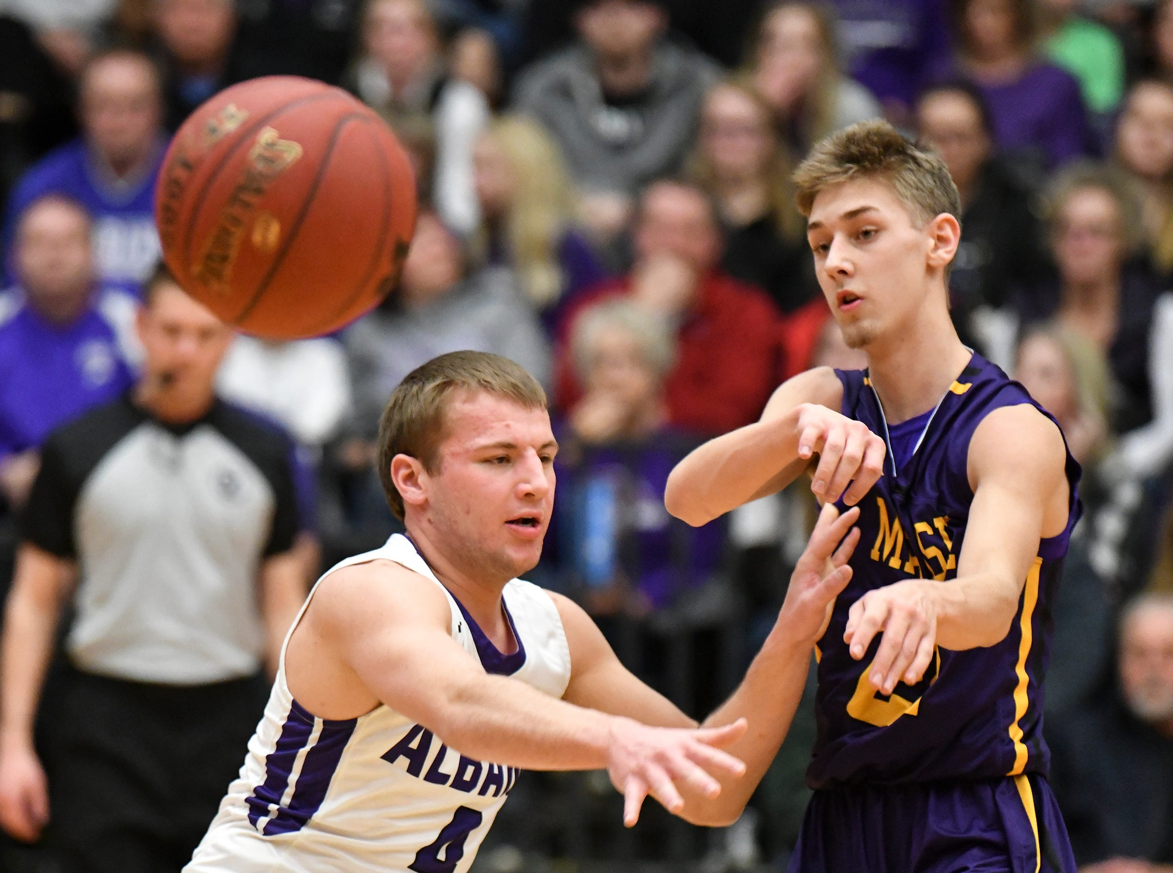 Grant Moscho of Melrose passes the ball during the first half of the Friday, March 15, Section 6-2A championship game at  Halenbeck Hall in St. Cloud.