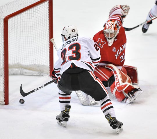 St. Cloud State's Robby Jackson scores on Miami goaltender Ryan Larkin during the first period of the Friday, March 15, game at the Herb Brooks National Hockey Center in St. Cloud.