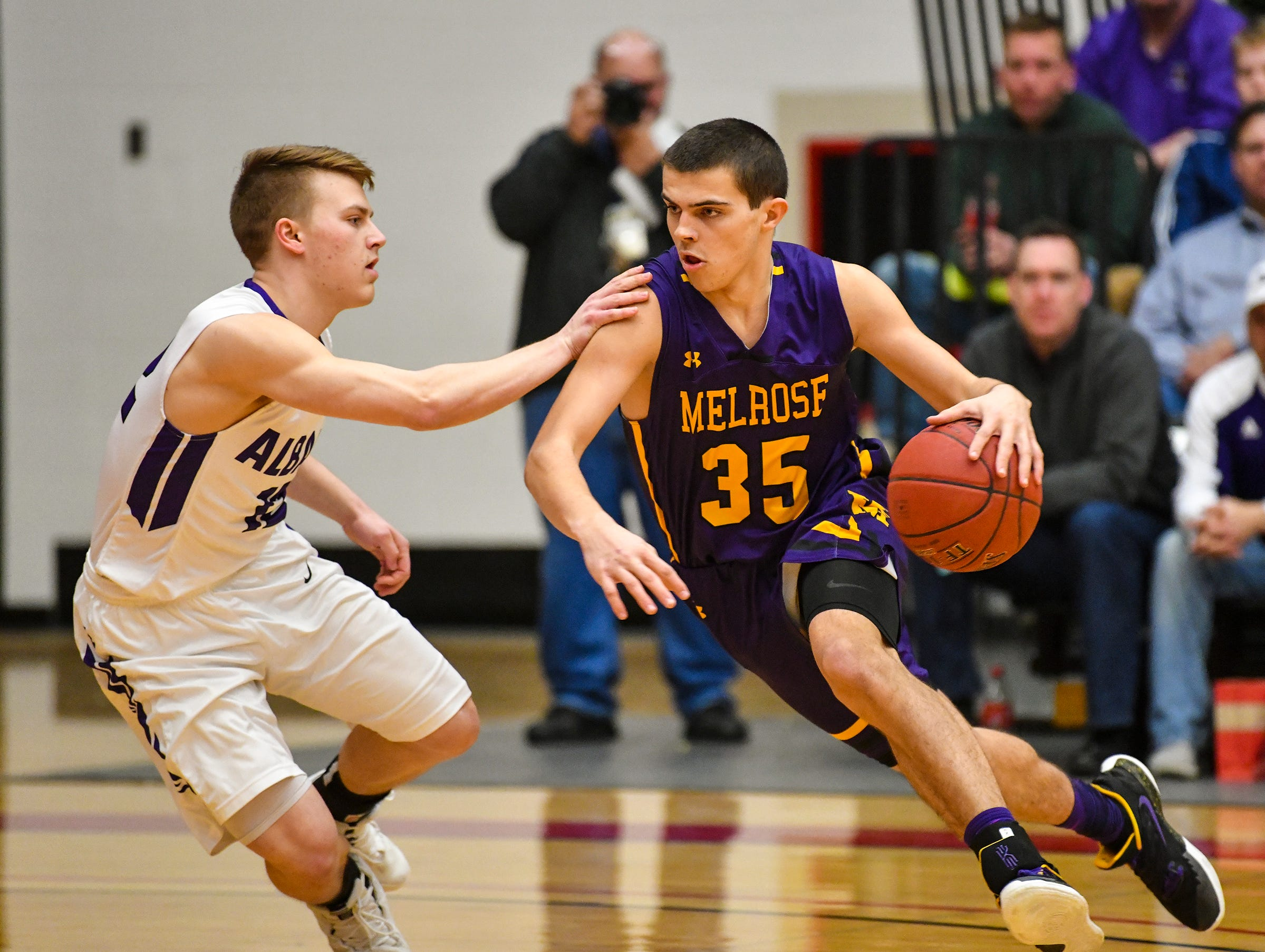 Preston Keaveny of Melrose drives to the hoop during the first half of the Friday, March 15, Section 6-2A championship game at Halenbeck Hall in St. Cloud.