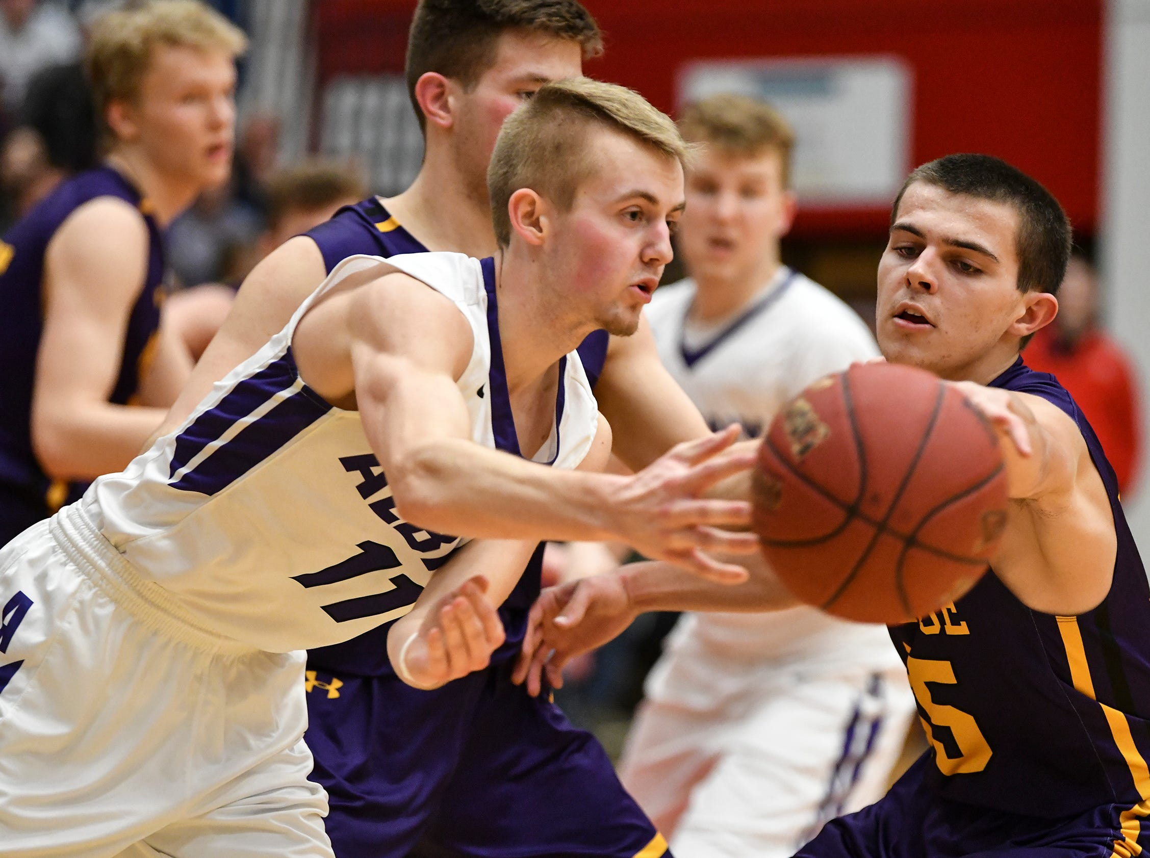 Albany's Jordan Schiffler is guarded by Preston Keaveny of Melrose  during the second half of the Friday, March 15, Section 6-2A championship game at the Halenbeck Hall in St. Cloud.