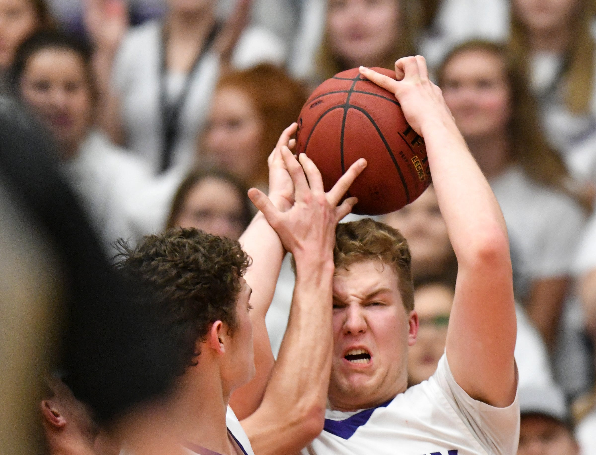 Albany's Andrew Hahn grabs a rebound during the first half of the Friday, March 15, Section 6-2A championship game at  Halenbeck Hall in St. Cloud.