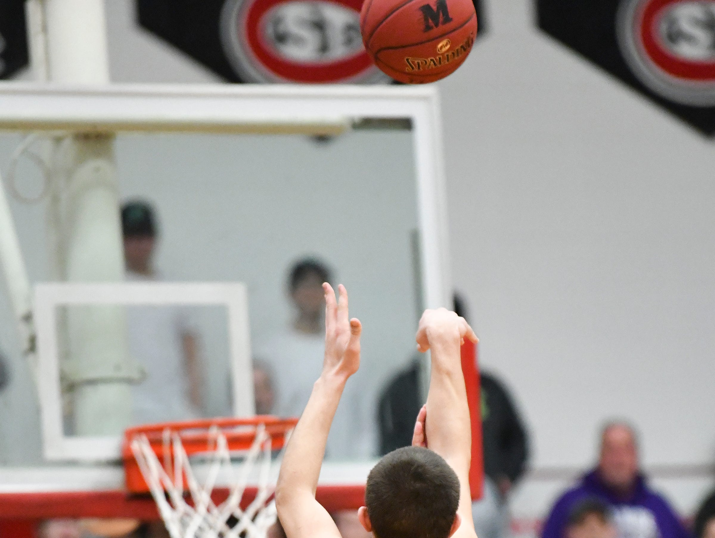 Preston Keaveny sinks a basket for Melrose during the second half of the Friday, March 15, Section 6-2A championship game at Halenbeck Hall in St. Cloud.
