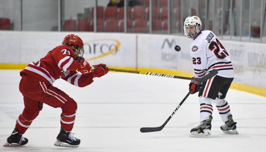 St. Cloud State's Robby Jackson concentrates on the puck during the first period of the Friday, March 15, game at the Herb Brooks National Hockey Center in St. Cloud.
