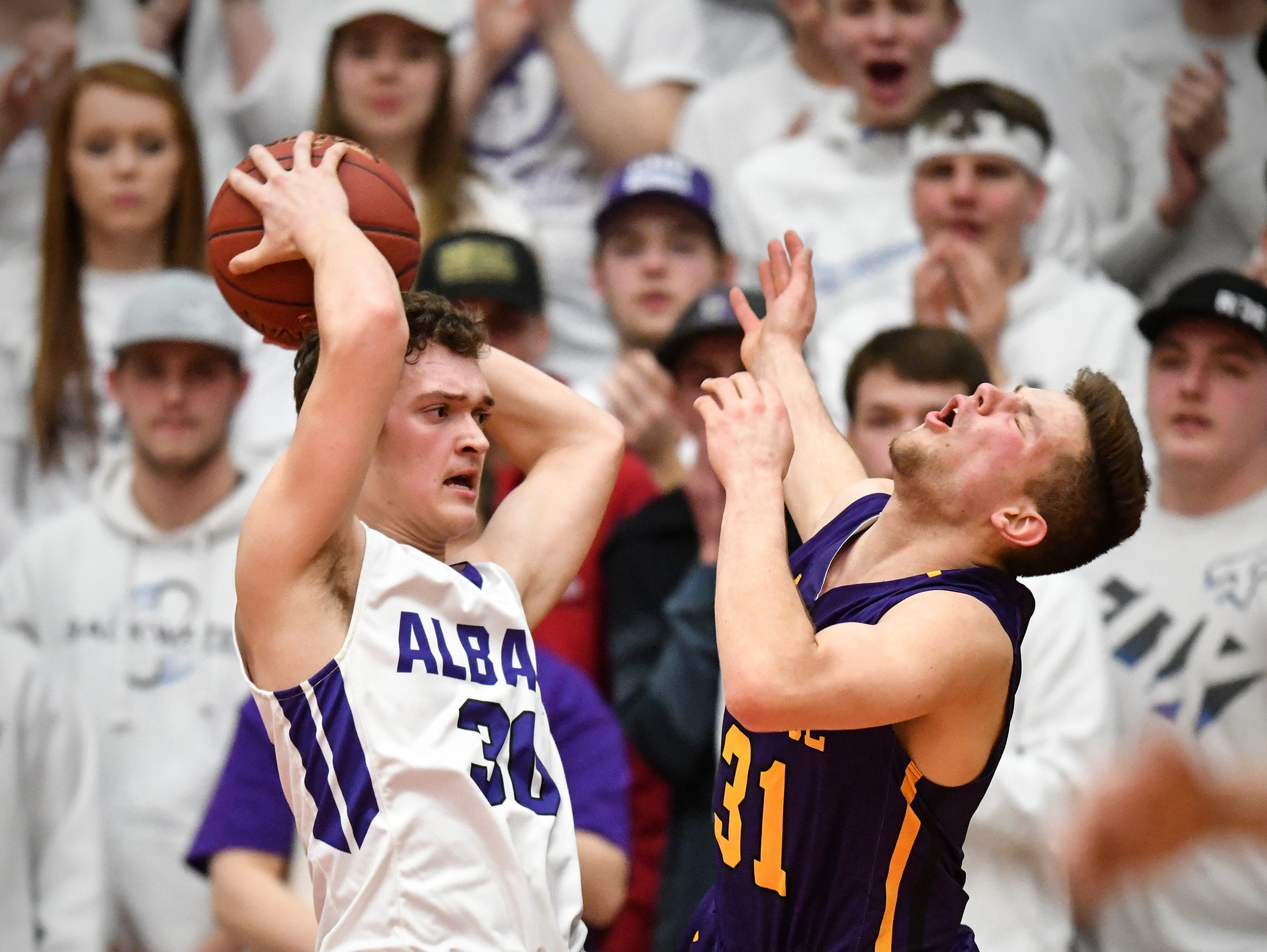 Albany's Ethan Navratil makes contact with Adam Helmin of Melrose during the first half of the Friday, March 15, Section 6-2A championship game at Halenbeck Hall in St. Cloud.