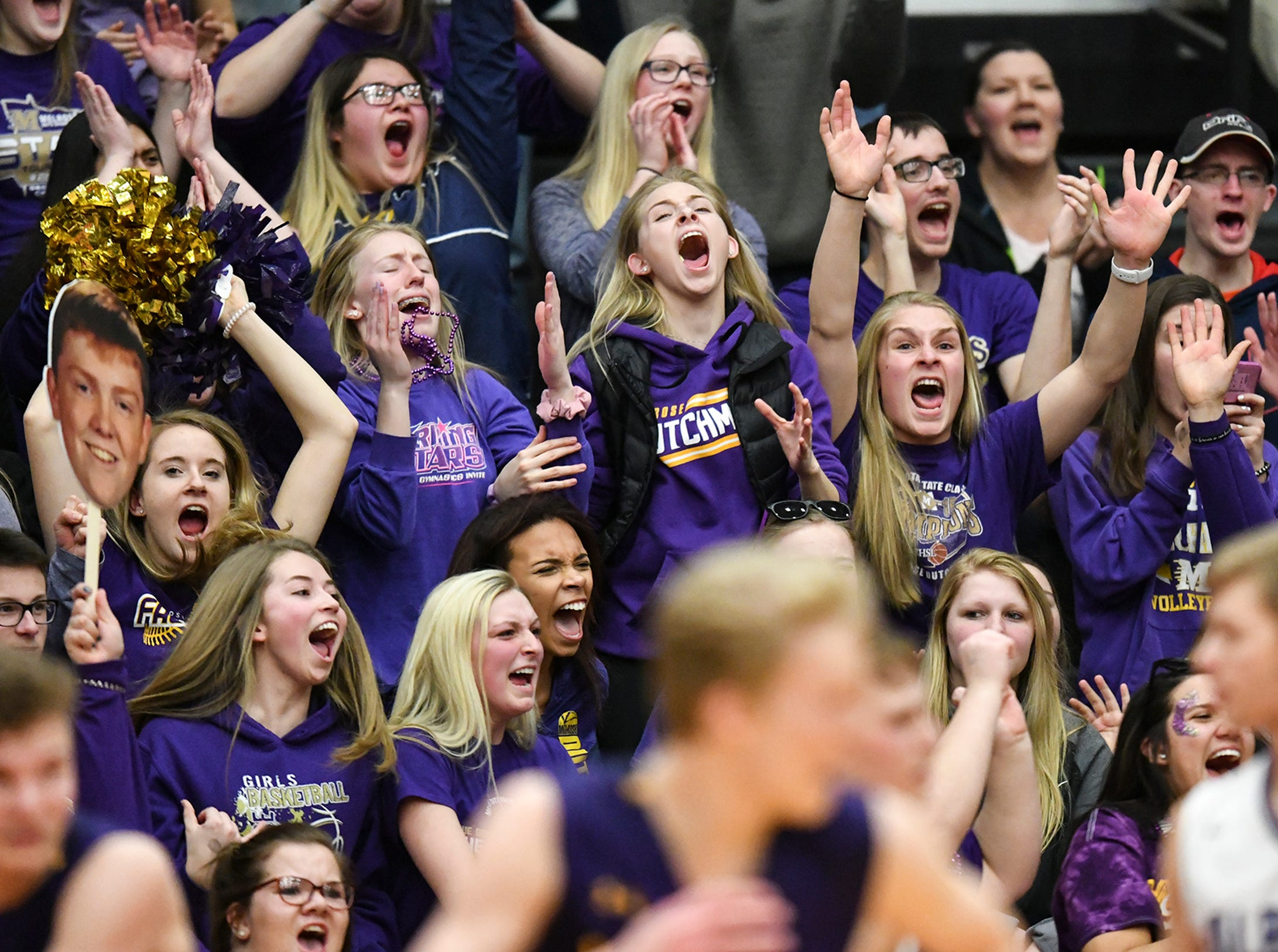 Melrose fans celebrate as their team wins the Section 6-2A championship game 52-51 against Albany at Halenbeck Hall in St. Cloud.
