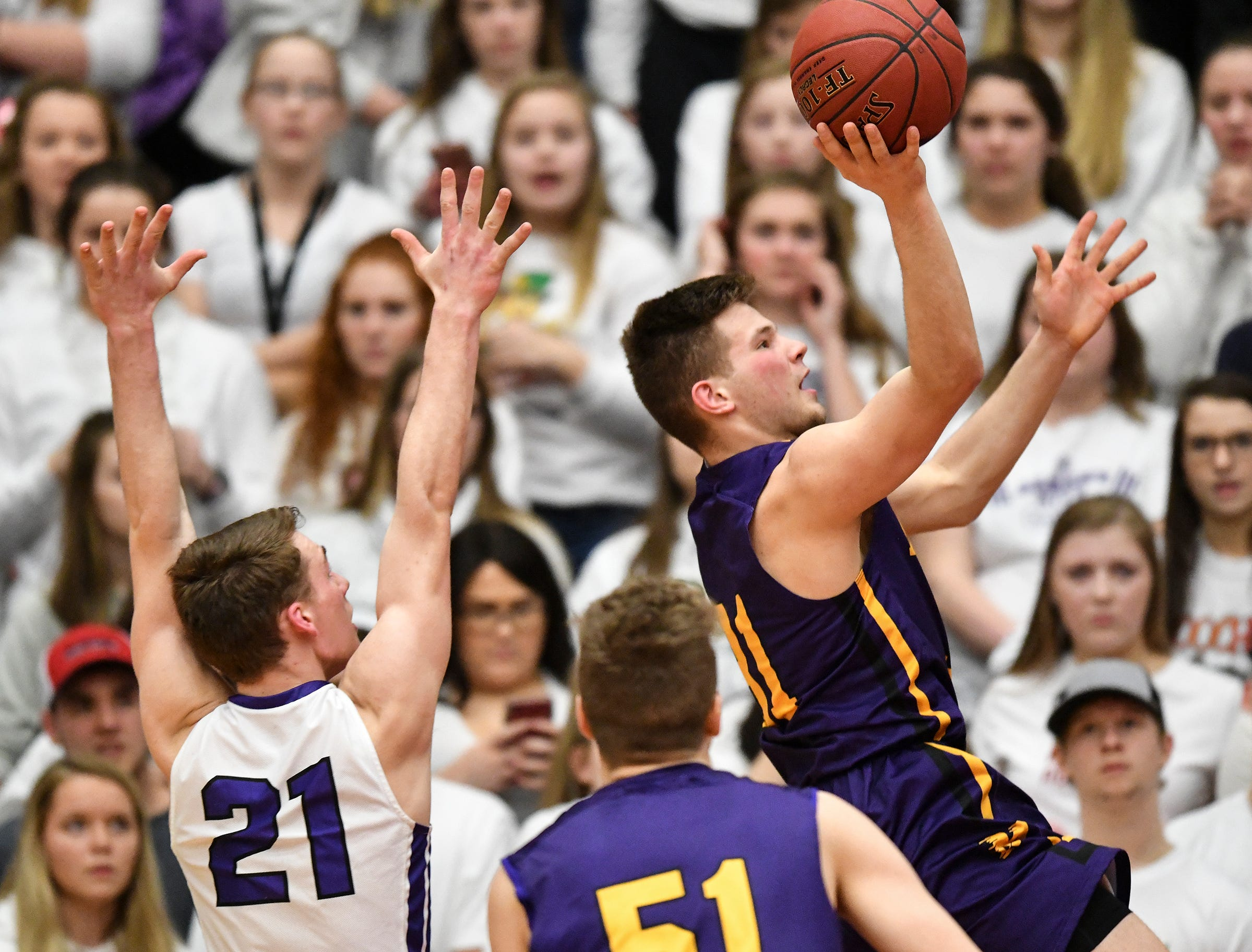 Adam Helmin puts up a shot for Melrose during the first half of the Friday, March 15, Section 6-2A championship game at  Halenbeck Hall in St. Cloud.