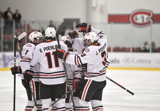 St. Cloud State players celebrate a goal during the first period of the Friday, March 15, game at the Herb Brooks National Hockey Center in St. Cloud.