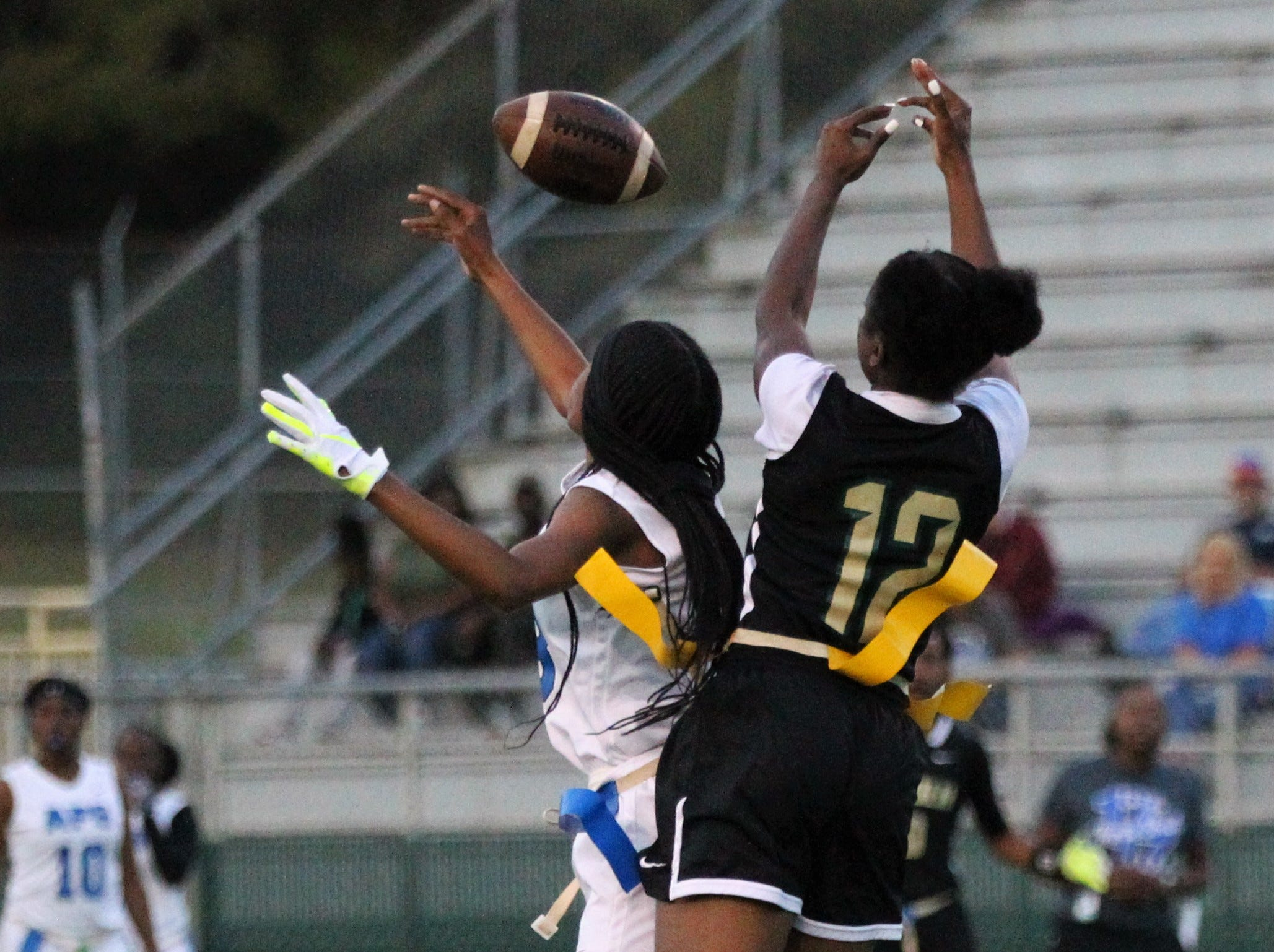 Godby receiver Gisele Jones managed to break up an interception and catch the ball for a long yardag as Godby's flag football team beat Lincoln 25-6 at Gene Cox Stadium on March 14, 2019.