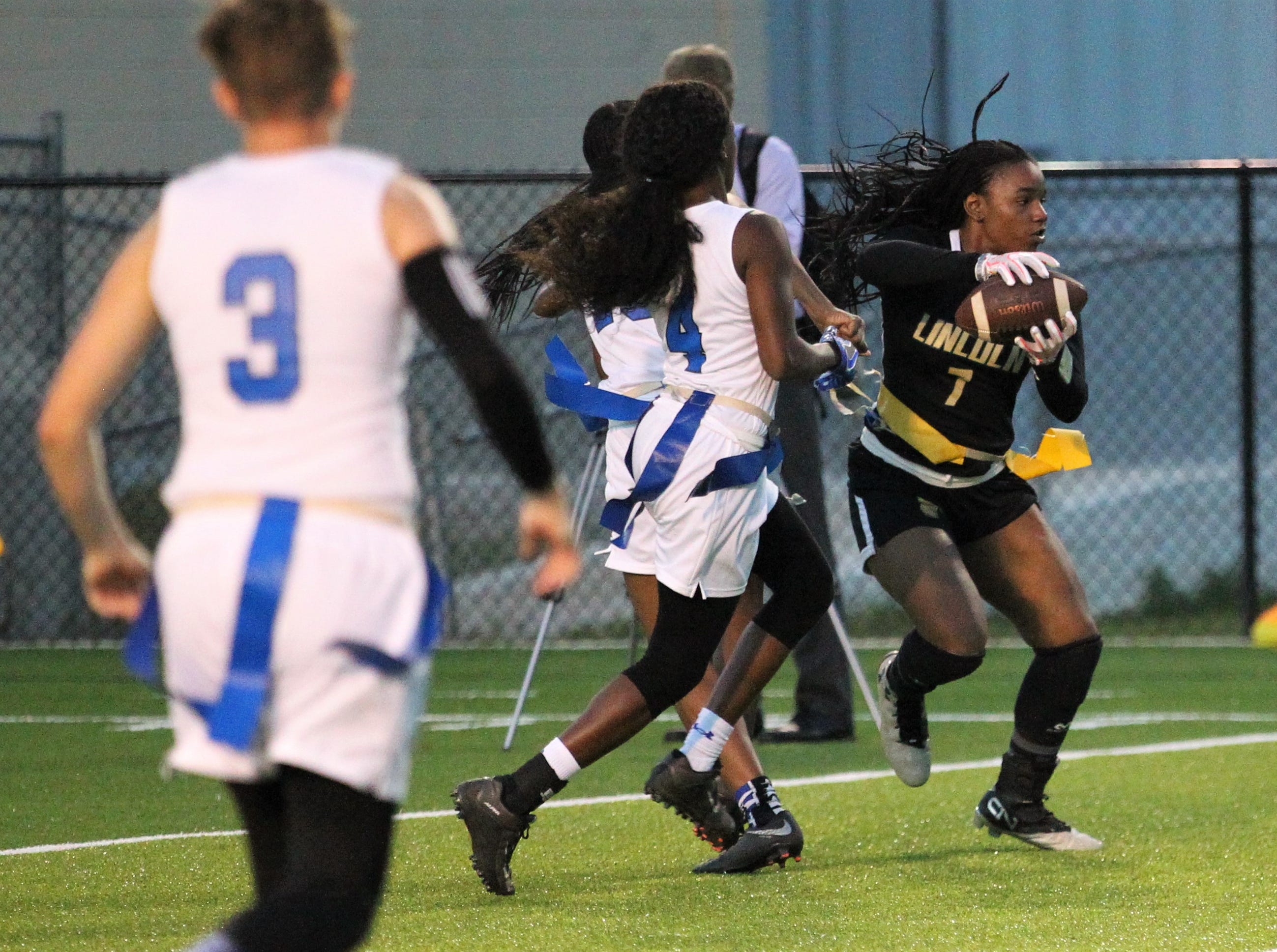 Lincoln sophomore Erin Turral catches a pass and turns upfield near the goal line as Godby's flag football team beat Lincoln 25-6 at Gene Cox Stadium on March 14, 2019.