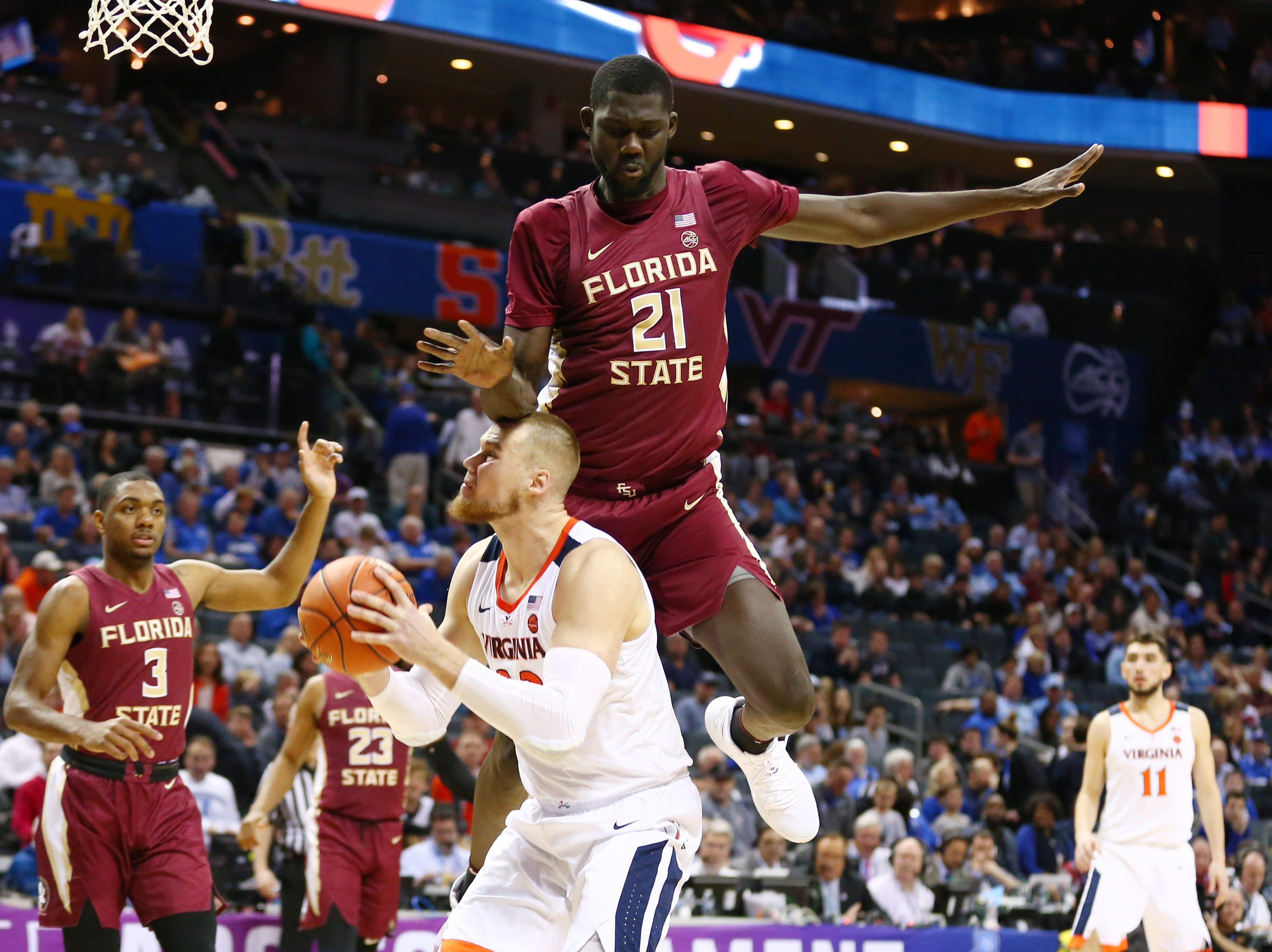 Mar 15, 2019; Charlotte, NC, USA; Virginia Cavaliers center Jack Salt (33) is fouled by Florida State Seminoles center Christ Koumadje (21) in the second half in the ACC conference tournament at Spectrum Center. Mandatory Credit: Jeremy Brevard-USA TODAY Sports