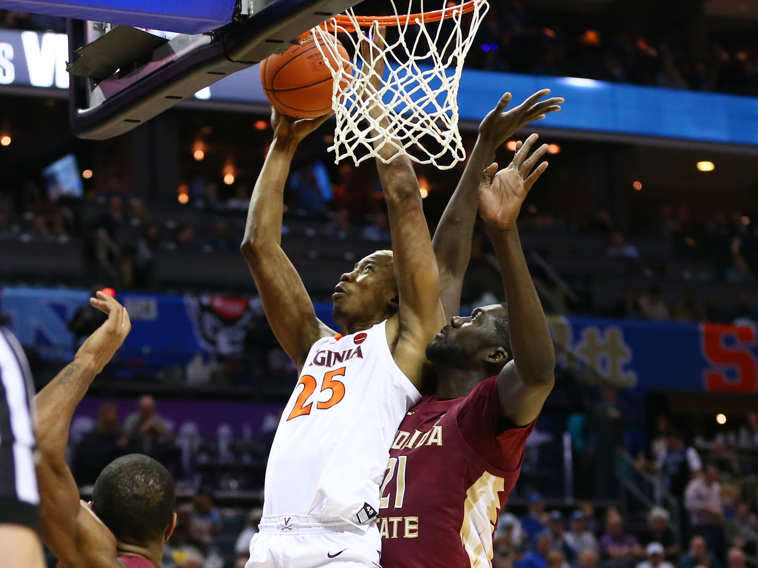 Mar 15, 2019; Charlotte, NC, USA; Virginia Cavaliers forward Mamadi Diakite (25) shoots the ball against Florida State Seminoles center Christ Koumadje (21) in the second half in the ACC conference tournament at Spectrum Center. Mandatory Credit: Jeremy Brevard-USA TODAY Sports