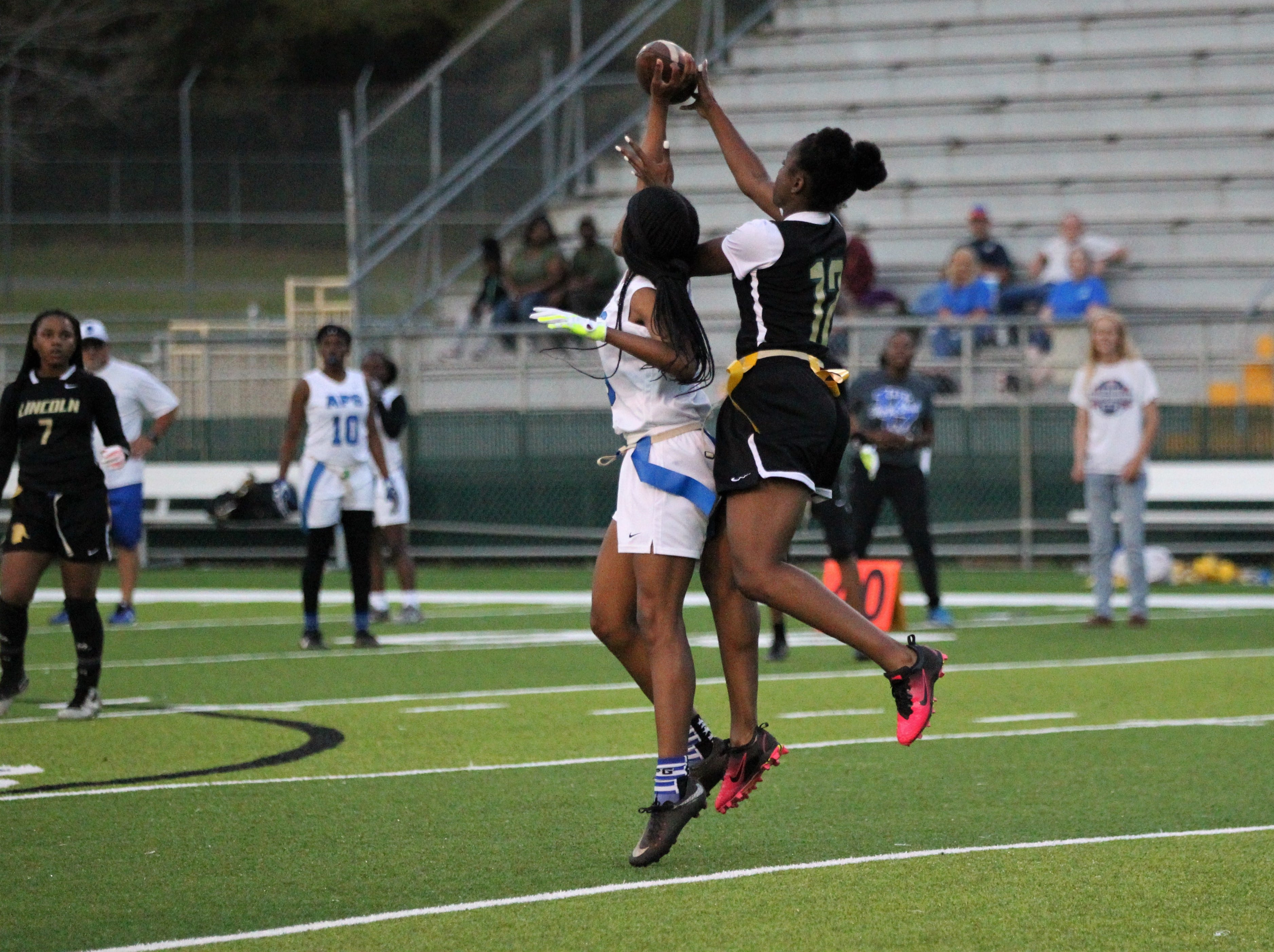 Godby receiver Gisele Jones managed to break up an interception and catch the ball for a long yardage as Godby's flag football team beat Lincoln 25-6 at Gene Cox Stadium on March 14, 2019.
