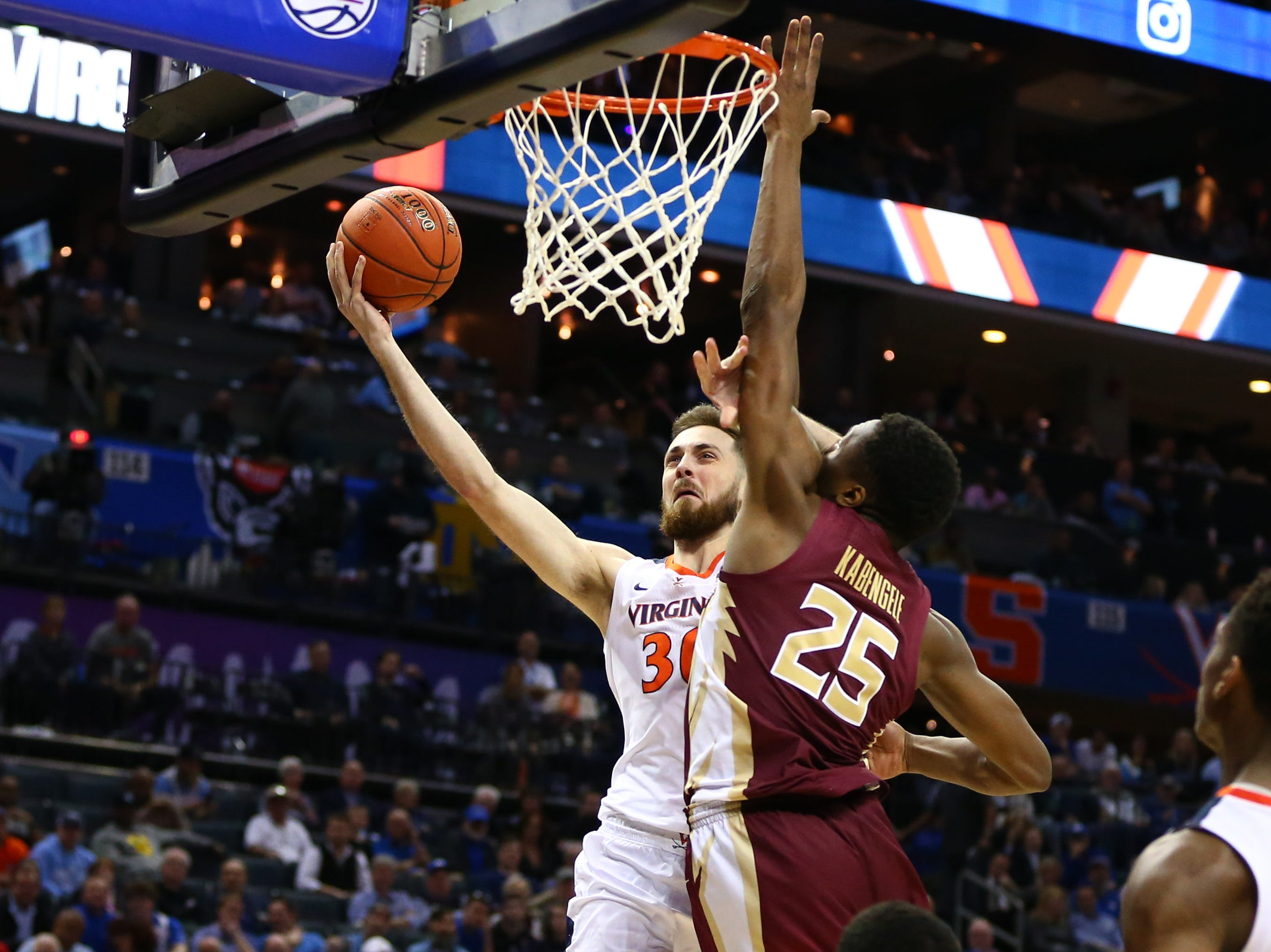 Mar 15, 2019; Charlotte, NC, USA; Virginia Cavaliers forward Jay Huff (30) shoots the ball against Florida State Seminoles forward Mfiondu Kabengele (25) in the second half in the ACC conference tournament at Spectrum Center. Mandatory Credit: Jeremy Brevard-USA TODAY Sports