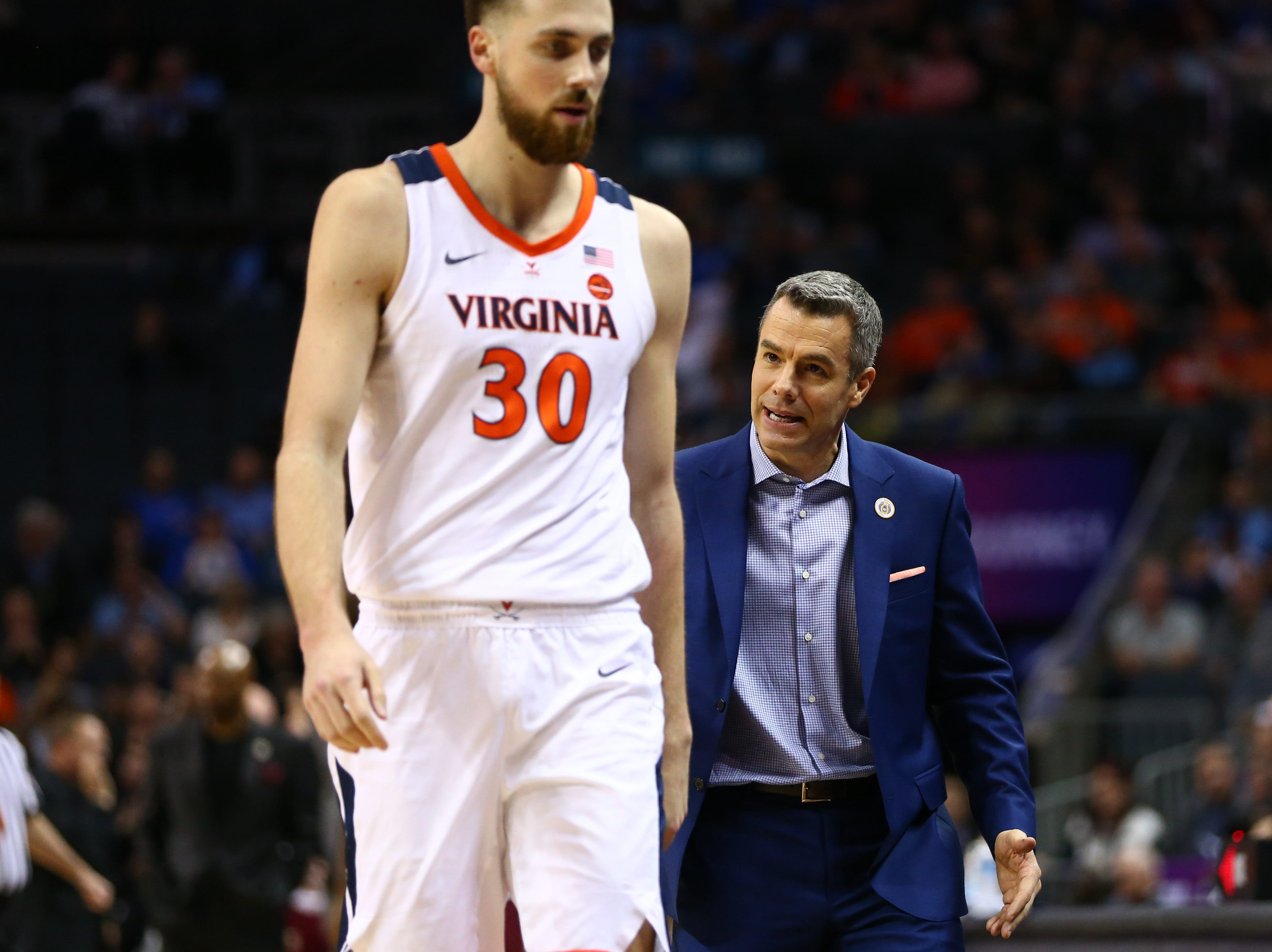 Mar 15, 2019; Charlotte, NC, USA; Virginia Cavaliers head coach Tony Bennett talks with forward Jay Huff (30) in the first half against the Florida State Seminoles in the ACC conference tournament at Spectrum Center. Mandatory Credit: Jeremy Brevard-USA TODAY Sports