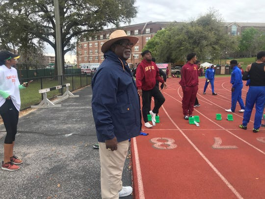 Gene Milton preps to fire the starter's pistol for the 100-meter dash at the FAMU Relays on March 16, 2019.