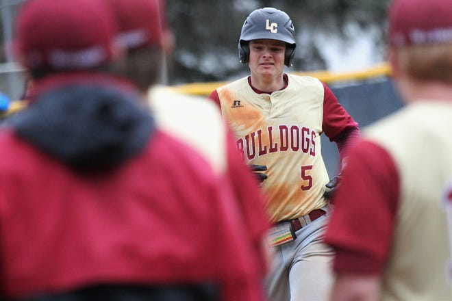 Liberty County senior Brice Dillmore runs off with emotion on his face after a three-run home run as the Bulldogs went on the road to beat Maclay 8-2 on Saturday, March 16, 2019. Liberty County's baseball coach Corey Crum died a week earlier in an accident at the school.