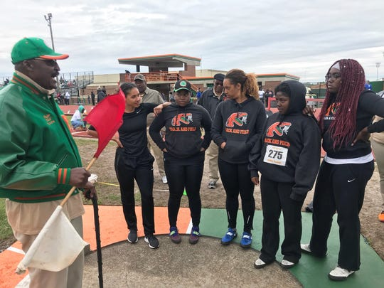 Major Hazelton goes over rules of the shot put with FAMU's throwers. The track legend was an official at the FAMU Relays on March 15-16, 2019.