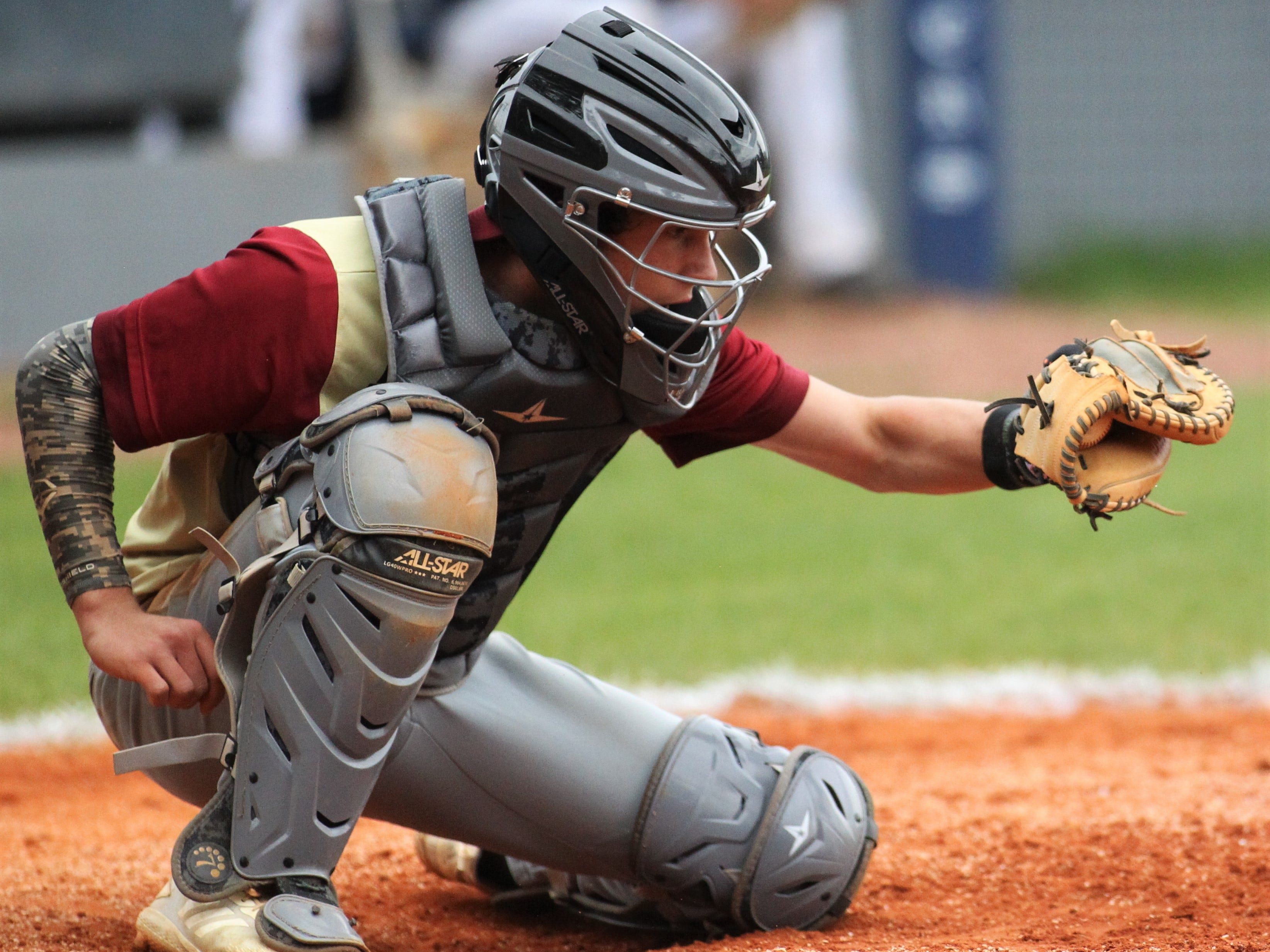 Liberty County catcher Austin Waller frames a strike as Liberty County's baseball team went on the road to beat Maclay 8-2 on Saturday, March 16, 2019. The Bulldogs played their first game following their head coach Corey Crum's tragic death six days ago.