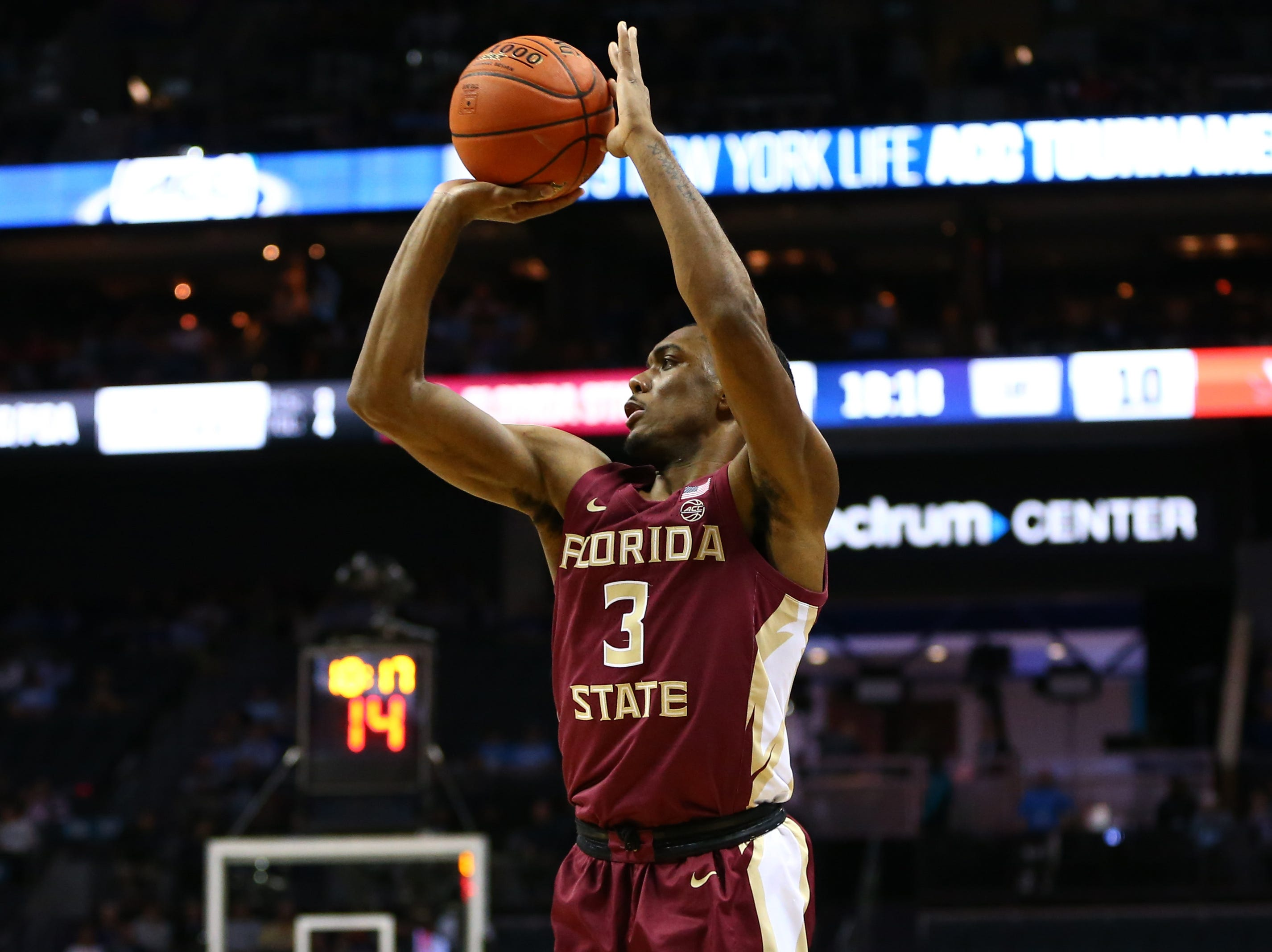 Mar 15, 2019; Charlotte, NC, USA; Florida State Seminoles guard Trent Forrest (3) shoots the ball against the Virginia Cavaliers in the first half in the ACC conference tournament at Spectrum Center. Mandatory Credit: Jeremy Brevard-USA TODAY Sports