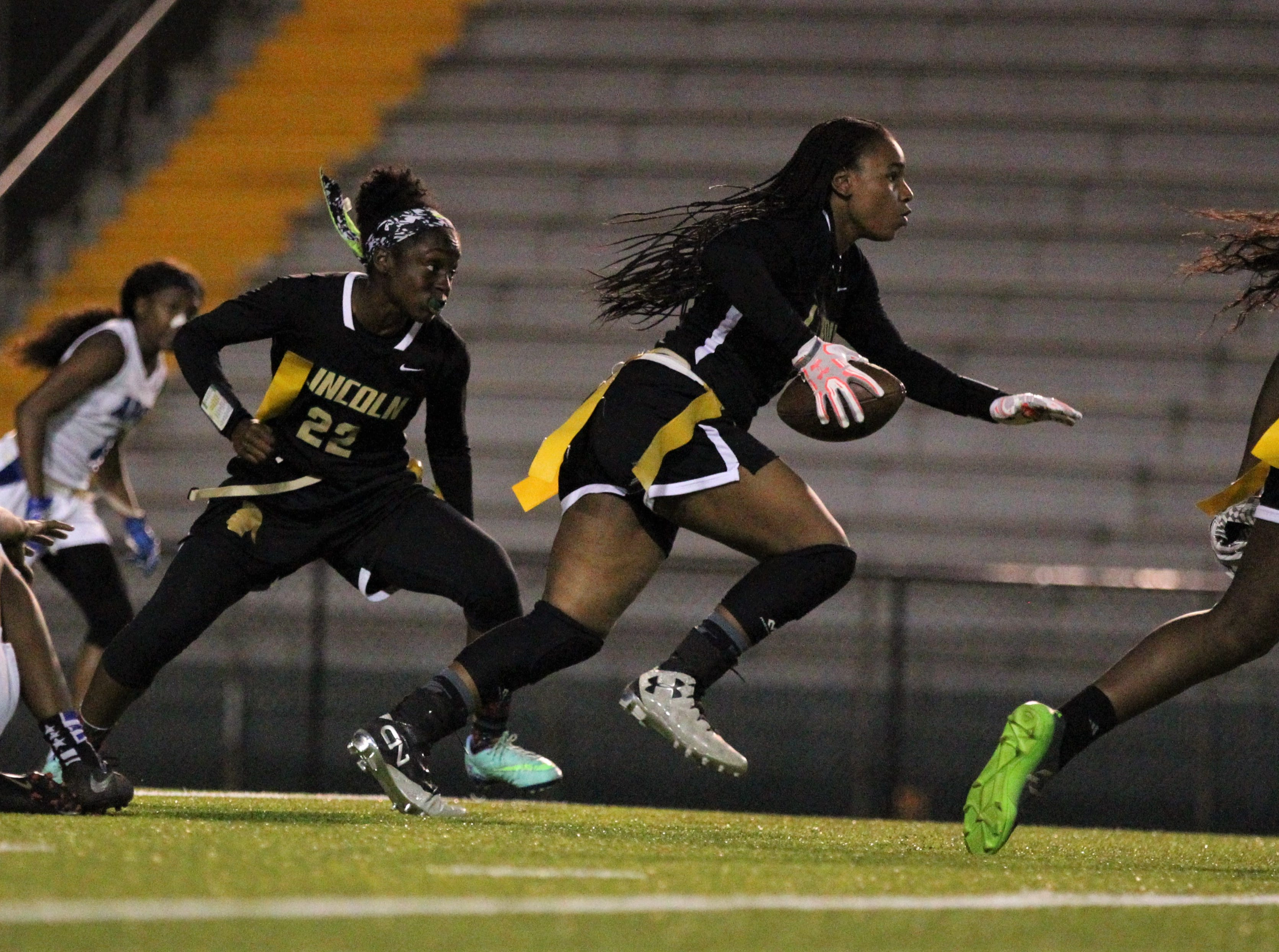 Lincoln's Erin Turral runs upfield after an interception as Godby's flag football team beat Lincoln 25-6 at Gene Cox Stadium on March 14, 2019.