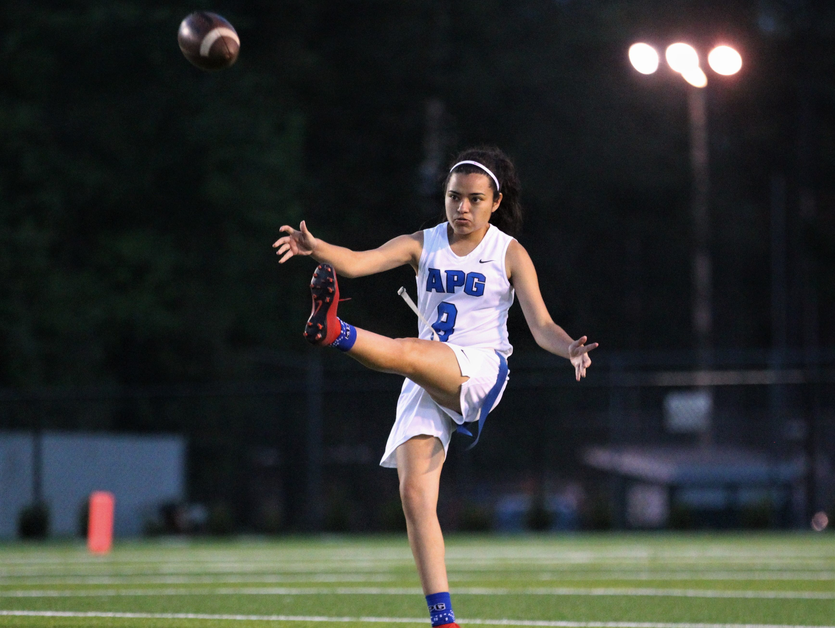 Godby senior Jocy Muniz punts a ball away as Godby's flag football team beat Lincoln 25-6 at Gene Cox Stadium on March 14, 2019.